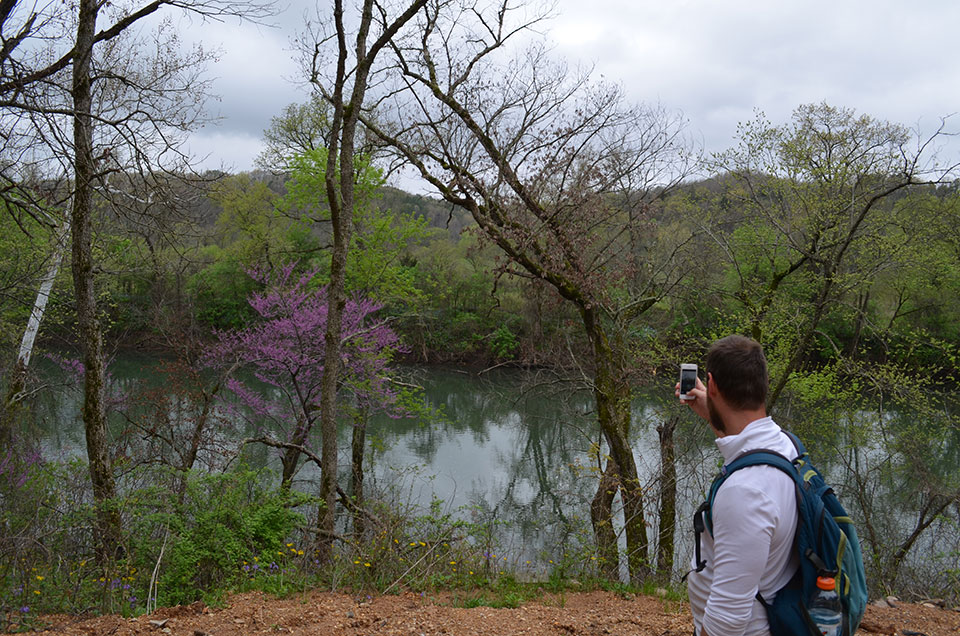 Scientists are not immune to natural beauty. Williams captures an image of a redbud in full bloom to send home—as soon as he can get out of the woods and near a town that has a cell signal.