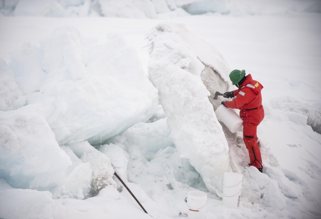 Tim sampling dirty ice. (photo C. Mendenhall).