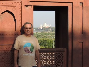 Standing next to a window in the Agra Fort with a view of the Taj Mahal farther down the Yamuna River.