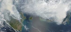 Thick smoke from El Nino-related fires shrouds the Indonesian islands of Sumatra (left) and Kalimantan (right), September 2015. (NASA)