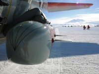 Moving across the ice with IcePod in the front and active Volcano Mt. Erebus in the distance.