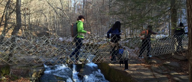 Students cross a cable bridge on the Sunday morning hike.