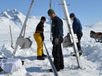 Collecting ice cores in Greenland. Courtesy of William D'Andrea