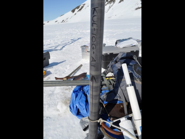 This sediment core, just collected from Kulusuk Lake, awaits transport back to the base camp.  (Photo courtesy of William D'Andrea)