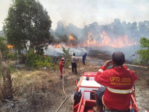Fighting wildfires in Indonesia.