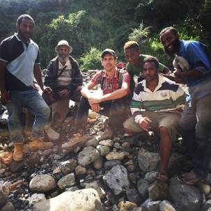 Joshua Fisher with several local community members who assisted in collecting samples.