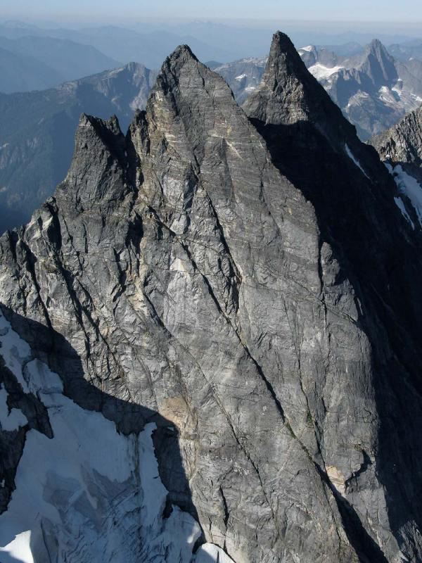 The McMillan Spires in North Cascades National Park have metamorphic rocks known as granulites that have equilibrated at pressure and temperature conditions typical of continental lower crust. Photo: John Scurlock/Jagged Ridge Imaging.