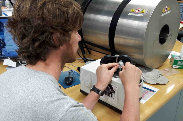 Jeroen van der Lubbe of the University of Amsterdam works with a cyrogenic magnetometer to analyze the magnetic properties of a sample. (Jens Gruetzner)