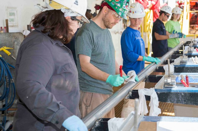 The team aboard the JOIDES Resolution collected the first four cores of Expedition 361 from the Natal Valley site. Here, scientists prepare to open the first. (Tim Fulton/IODP)