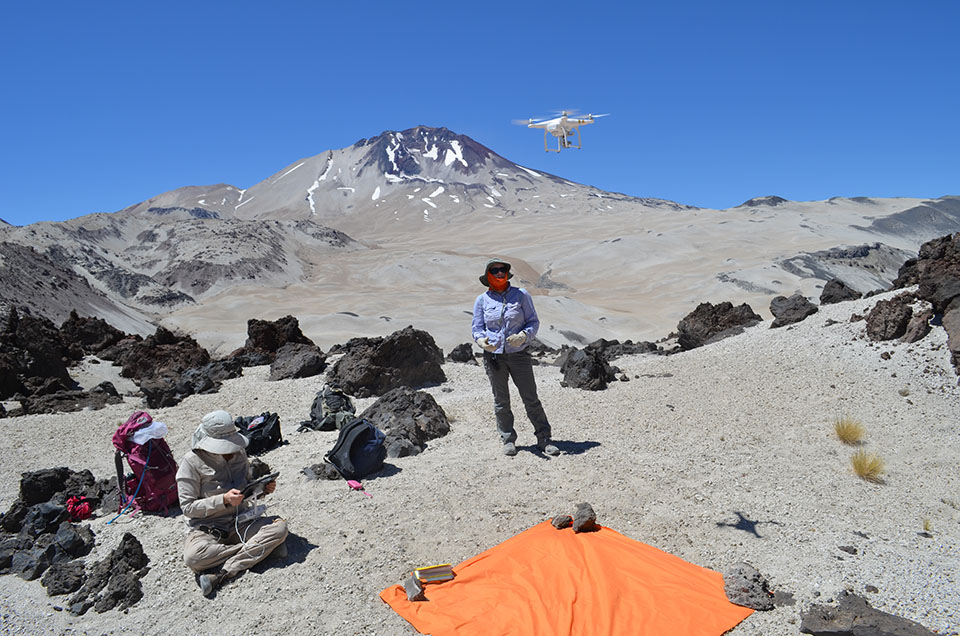 Lamont-Doherty volcanologists Einat Lev (left) and Elise Rumpf launch a camera-equipped drone over the great lava flow. They will assemble hundreds of high-resolution aerial images into a detailed topographical map, aimed at understanding the forces that directed the flow.