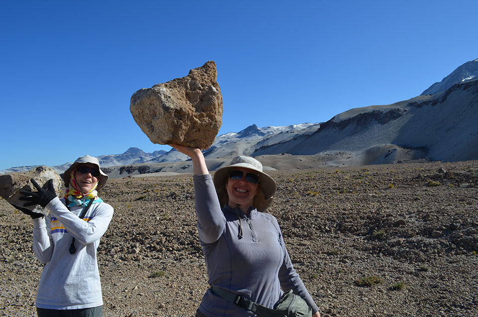 Due to simple gravity, the pumice fragments expelled from Quizapu get progressively bigger as you near the crater. University of Hawaii PhD. student Emily First (left) and Lamont-Doherty volcanologist Einat Lev are strong, but it also helps that bubble-filled pumice is lighter than your average rock.