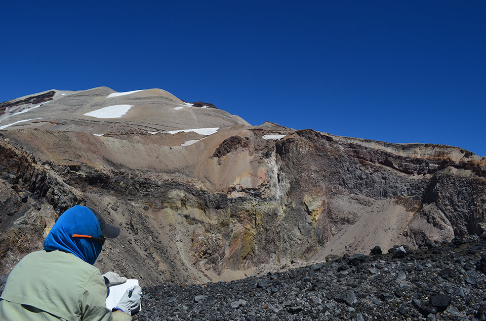 University of Hawaii geologist Julia Hammer notes the crater's structure. Its walls show a tortured history of repeated heating, deformation and explosions. Colorful stains indicate the rocks could be rich in valuable metals.