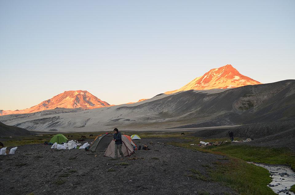 Sunset on the valley floor below fires up Descabezado Grande (left) and its companion peak, 12,428-foot Cerro Azul. The Quizapu crater lies hidden on Cerro Azul's flank.
