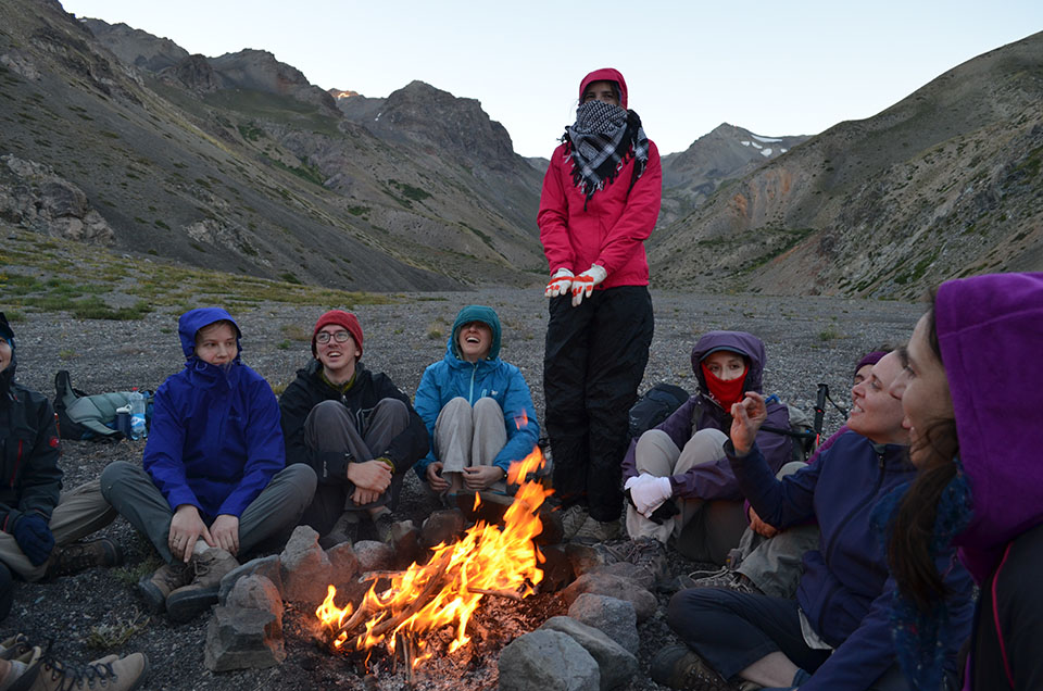 As night falls in the mountains, temperatures plunge. Students and scientists take advantage of a fire built from scavenged fragments of shrubs.