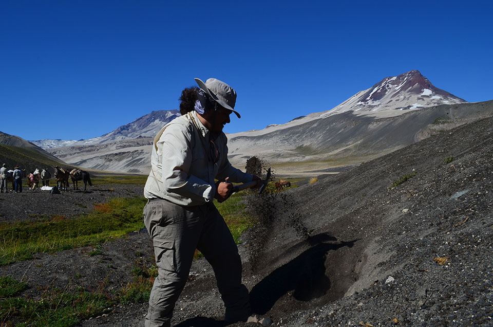 Francisco García Araya, a graduate student at Chile's University of Concepción, shovels into an ash deposit. Like an archaeological dig, excavations through successive layers can tell a story of a volcano's past.