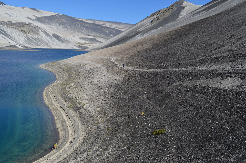 Frequent lava flows and ash falls create dead-end drainages where lakes can form. But even in the presence of water, rock-strewn landscapes remain largely lifeless.