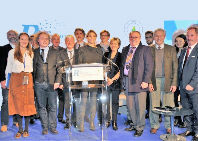 "The Climate City team receiving the Generali Grand Prize for its innovative approach to climate challenges, on Nov. 23, 2015, at the second edition of ""Les Respirations"" in Paris, the first conference solely dedicated to air quality. Yves Tourre, an adjunct senior research scientist at the Lamont-Doherty Earth Observatory, stands just to the right of the podium."