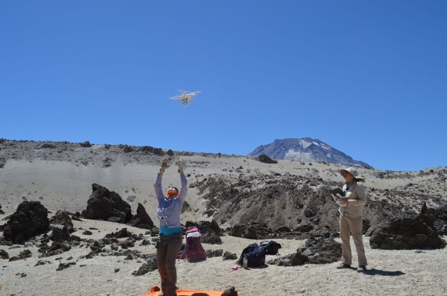 Flying the drone on the lava flows, with Descabezado Grande in the background. Photo: Kevin Krajick