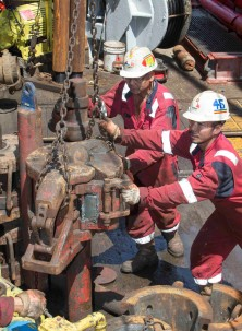 The drilling crew works with equipment aboard the JOIDES Resolution. Photo: Tim Fulton/IODP