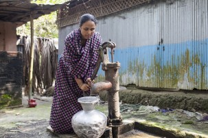 Jhohora Akhter, 30, of Iruain village, draws water from the family well, which is contaminated with arsenic. Jhohora's mother Jahanara Begum died of arsenic-related health conditions. Her father suffers from diabetes, an illness associated with chronic arsenic exposure. Her brother Ruhul Amin also suffers arsenic-related health conditions. Photo: © 2016 Atish Saha for Human Rights Watch