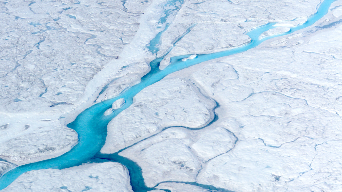 Rivers of meltwater flow across the Greenland ice sheet. Where their cold freshwater enters the ocean may make a difference for the global climate, a new study suggests. M. Tedesco/Columbia University