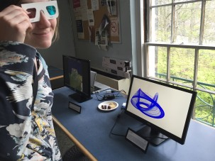 "DEES graduate student Laura Haynes dons 3D goggles to view Jonny Kingslake's video ""The Nye Attractor"""