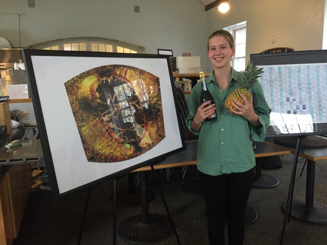 DEES graduate student Anna Barth poses with her award winning image of a thin section micrograph of garnet and mica.