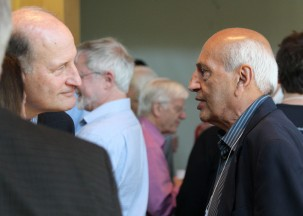 Former Lamont Director Manik Talwani, right, speaks with geologist Roger Buck during a break.