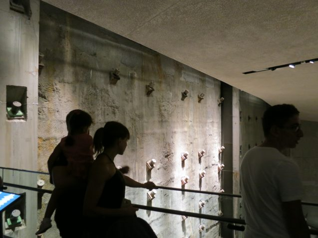Visitors to the underground September 11 Museum view the massive retaining wall that once surrounded the towers' foundations. Seismic waves from the collapse first passing through this wall were detected more than 250 miles off. (Kevin Krajick)