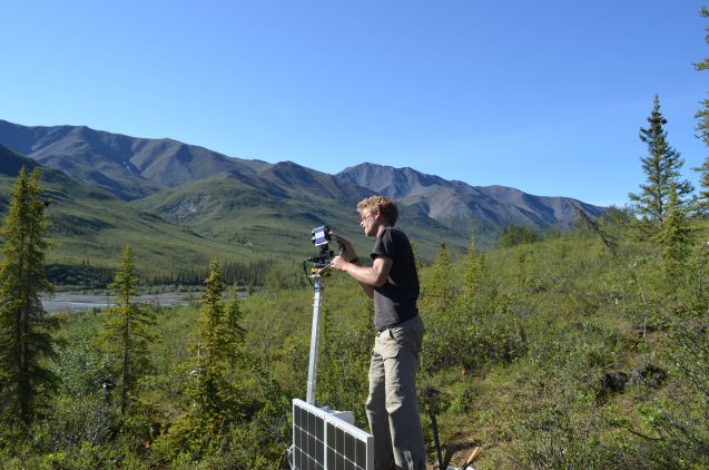 Team leader Jan Eitel of the University of Idaho sets up a solar-powered radar camera that will scan a study site continuously for years, to capture how trees respond to changing conditions.