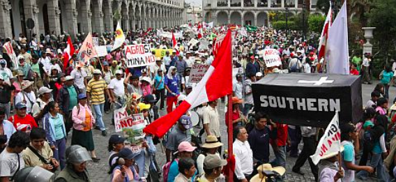 One of the many demonstrations against the Tia Maria mining project in Perú, closely watched by Peruvian law enforcement. Photo from website of Peruvian politician Rosa Maria Palacios