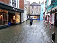 A man wades through a flooded Cornwall street after severe winter storms hit the United Kingdom. (Image: Pixabay)