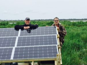 Keith and I pose by our newly installed solar panels . These will power both the GPS and the optical fiber strainmeters.