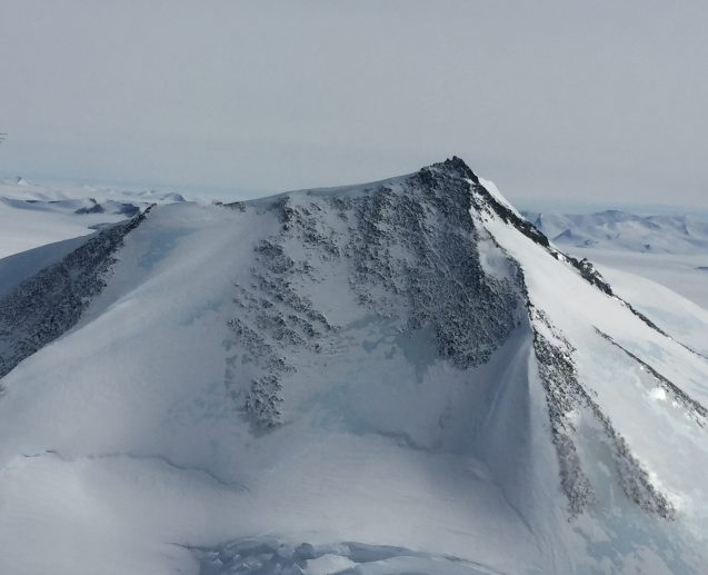 A snow covered mountain peak in the Antarctic Peninsula reaches skyward some 7000 ft. into the air. (Photo M. Turrin)