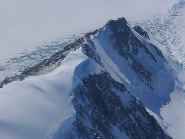 The Antarctic Peninsula has elevation rising 8000 ft. with ice covering the tops of the mountains in thick layers. (Photo M. Turrin)