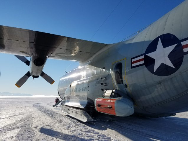 IcePod on the side of the New York Air National Guard LC130 Skier 92, on the ice shelf in Antarctica. (Photo N. Frearson)