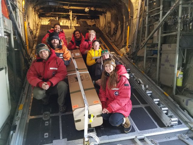 ROSETTA team gathered around the Alamo float as it is loaded on the plane for deployment in front of the Ross Ice Shelf.