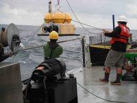 Deploying an ocean bottom seismometer from the R/V Oceanus. Photo: Lamont-Doherty