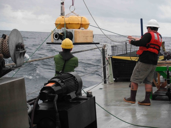 Deploying an ocean bottom seismometer from the R/V Oceanus. Photo: Lamont-Doherty