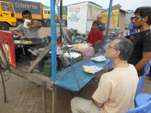 Having a breakfast of an omelet and paratha while waiting at the ferry ghat (dock) at Mawa.
