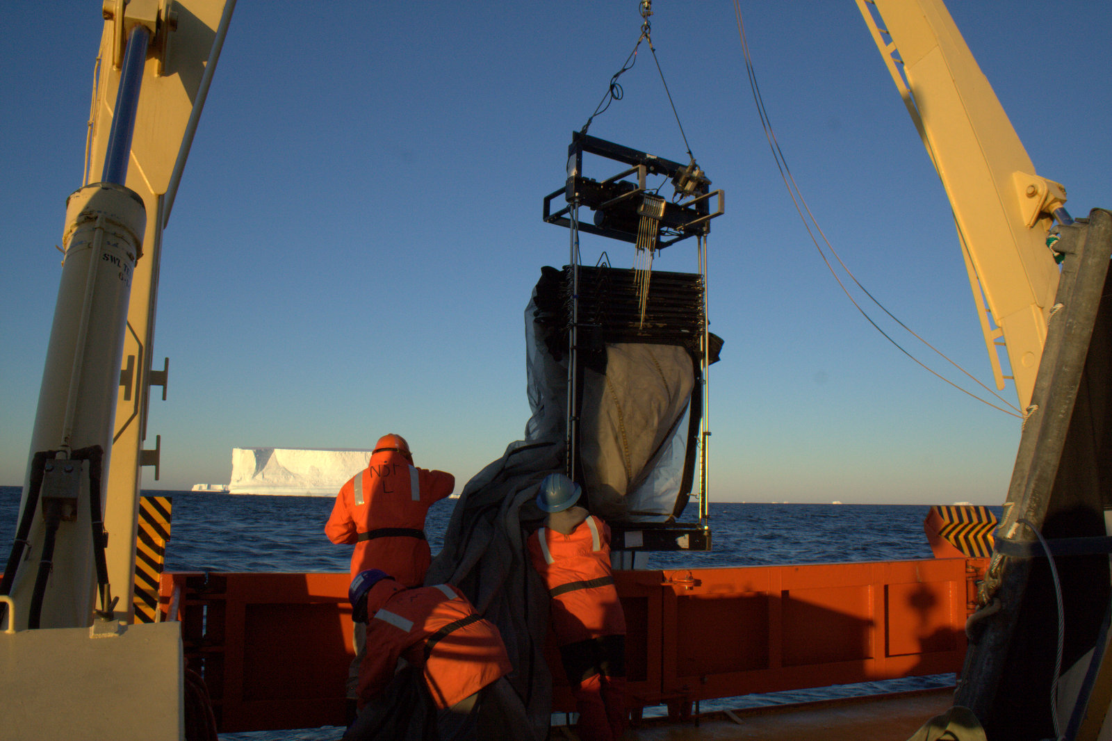 Scientists launch a Multiple Opening/Closing Net and Environmental Sensing System (MOCNESS) from the R/V Gould off the West Antarctic Peninsula. When towed behind a research vessel, the system's nets collect plankton while sensors provide real-time information about the physical properties of the seawater. Photo: Naomi Shelton/LDEO