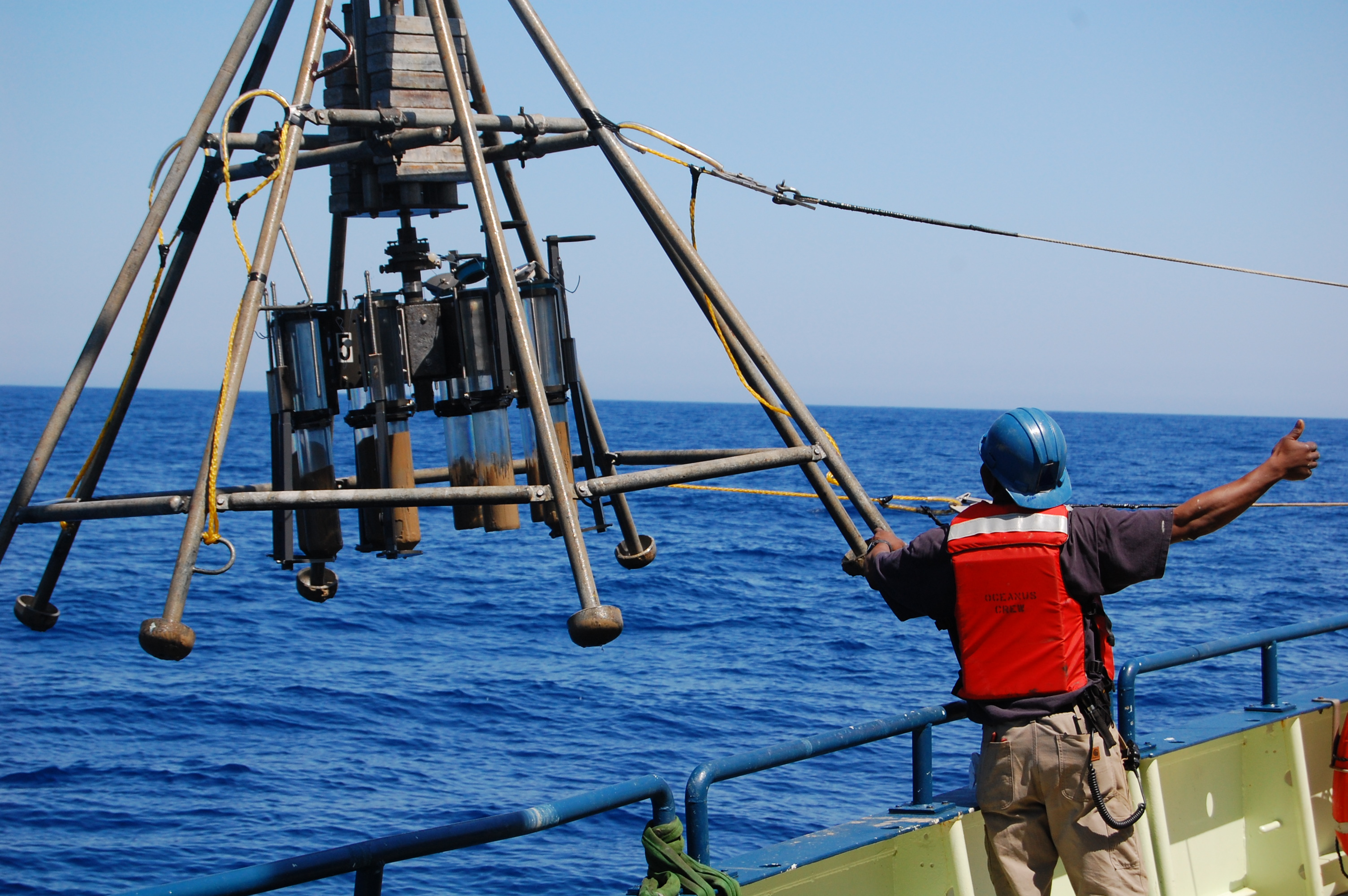 A multicorer device being lowered into the ocean takes eight one-foot cores from the seafloor. Scientists analyze such cores for clues to the climate of the past several thousand years. Image: Peter deMenocal
