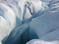 Meltwater from the Greenland ice sheet can travel through channels to reach bedrock; a new study shows where the water goes. Here, water plunges down a moulin, or hole in the ice. Photo: Marco Tedesco/Lamont-Doherty Earth Observatory
