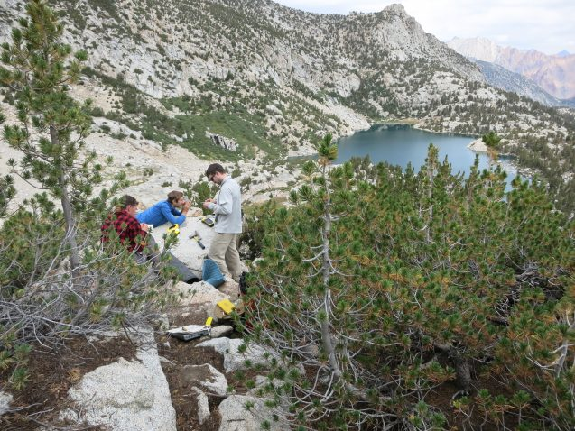 From left, Aaron Putnam, Adam Hudson and Ben Hatchett calculate the exact position of a boulder they've sampled above Baboon Lakes in the Sierras of central California. Photo: David Funkhouser