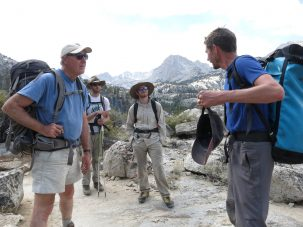 From left, Scott Mensing, Adam Hudson, Ben Hatchett and Aaron Putnam. Their work took them high into the John Muir Wilderness area. No power tools allowed: All of the rock sampling was done by hand chiseling and drilling.