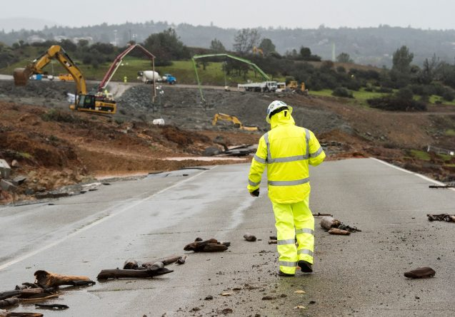 A worker walks down the damaged roadway near the Oroville Dam emergency spillway. The California Department of Water Resources continues to examine and repair the erosion with more than 125 construction crews working around the clock. Photo: Brian Baer/ California Department of Water Resources