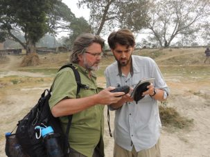 Chris and Dan discussing notes on locations to visit based on recent satellite images and entering them into the GPS.