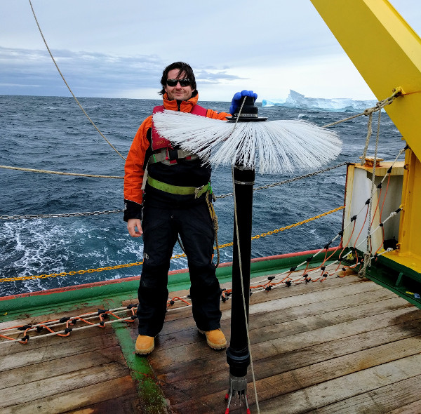 Coauthor Pierre Dutrieux with an instrument that detects fluctuations in ocean water, Terra Nova Bay, Antarctica, Jan. 31, 2017. A similar instrument was used to show why fresh water from melting ice shelves settles far below the surface instead of rising. (Courtesy Pierre Dutrieux/Lamont-Doherty Earth Observatory