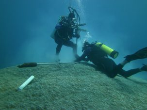 Scientists collect coral reef core samples near American Samoa. Photo: Brad Linsley