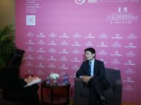 Dong Guo talks to Chinese media during the annual China Fashion Forum in Beijing on March 29.